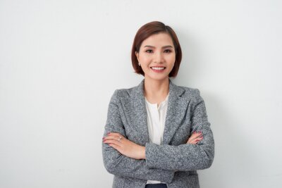 Fototapeta Entrepreneur young asian woman, business woman arms crossed on white background.