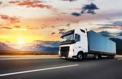 Fototapeta European truck vehicle with dramatic sunset light