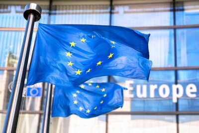 Fototapeta European Union flags waving in front of European Commission.