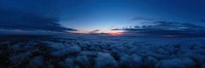 Fototapeta evening sunset sky panorama with some clouds. Panorama over clouds