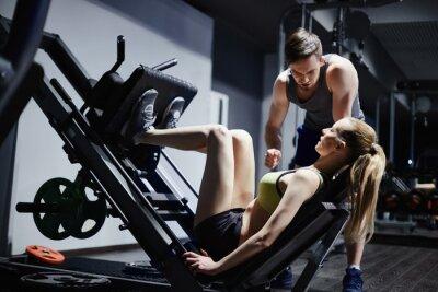 Fototapeta Exercising in gym