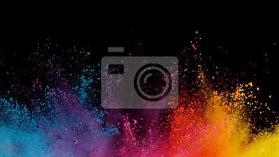 Fototapeta Explosion of colored powder on black background