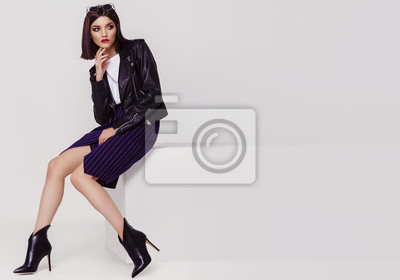 Fototapeta Fashion portrait of a young woman in black leather jacket
