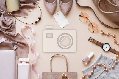 Fototapeta Fashion women stylish accessories outfit glamour set with label flat lay beige pastel background table with copy mock up space, female clothing offers shopping sale concept, above top view close up