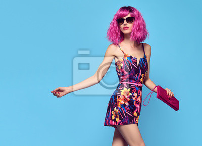 Fototapeta Fashionable female model with Pink Hair, Trendy Sunglasses. Stylish Party Glamour Outfit. Young Beautiful European girl Posing in Studio. Gorgeous fashion woman