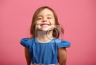 Fototapeta Female portrait of charming child of three years with a beautiful smile.