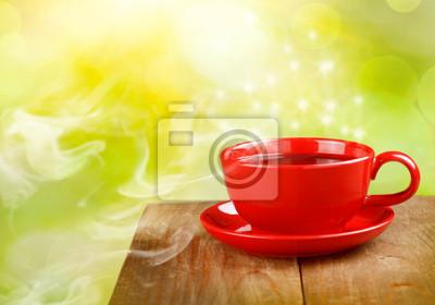 filiżanka herbaty lub kawy na tle słonecznej magii