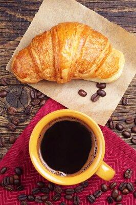 Fototapeta Filiżanka kawy z rogalikiem