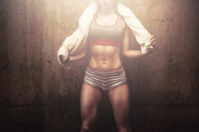 Fototapeta Fitness woman after hard workout training holding white sports towel