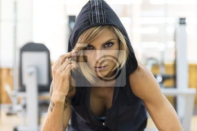 Fitness woman in sportswear looking at camera