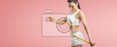 Fototapeta Fitness woman weight loss, slim body, healthy lifestyle concept