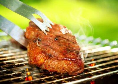Fototapeta Flames grillu stek z grilla. Beef Steak Barbeque Grill