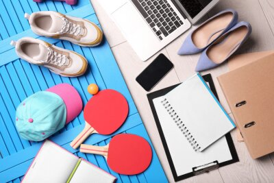 Fototapeta Flat lay composition with business supplies and sport equipment on color background. Concept of balance between work and life