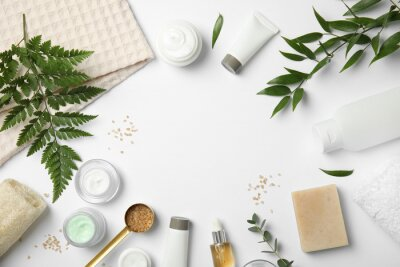 Fototapeta Flat lay composition with different body care products and space for text on white background