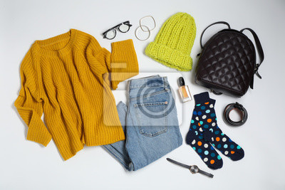 Fototapeta Flat lay composition with female winter clothes on white background