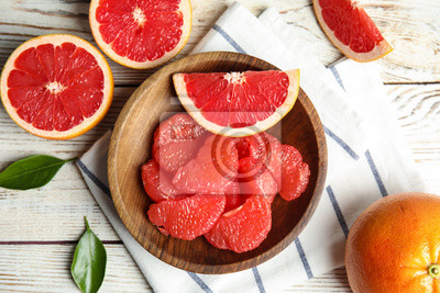 Fototapeta Flat lay composition with grapefruits on wooden background