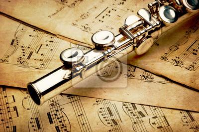 Flet srebrny w starożytnej tło muzyczne