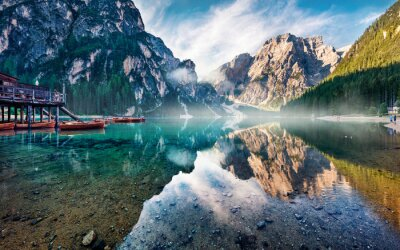 Fototapeta Foggy morning view of Braies (Pragser Wildsee) lake. Majestic summer sunrise in Fanes-Sennes-Braies national park, Dolomiti Alps, South Tyrol, Italy, Europe. Beauty of nature concept background.