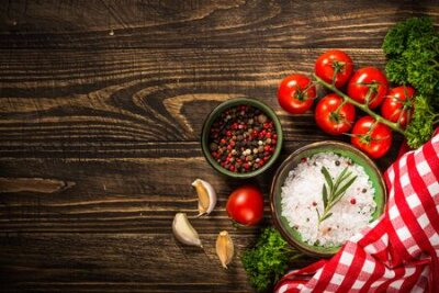 Fototapeta Food cooking background on wooden kitchen table.