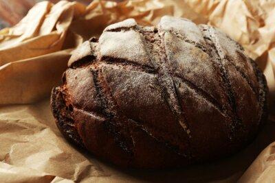 Fototapeta Fresh bread on paper close up