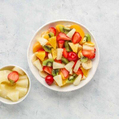 Fototapeta Fresh chopped fruit salad in a bowl.