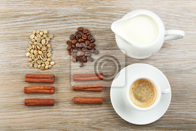Fresh coffee with ingredients on wooden background