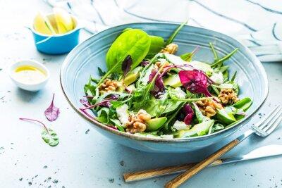 Fototapeta Fresh colorful spring salad - avocado, walnuts and feta cheese