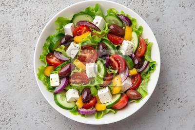 Fototapeta fresh greek salad ( tomato, cucumber, bel pepper, olives  and feta cheese) in white bow