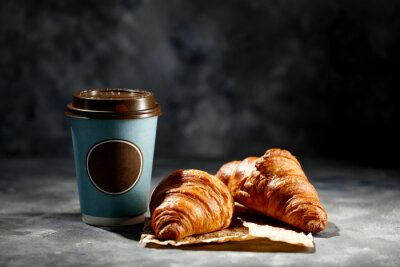 Fresh hot coffee and croissant
