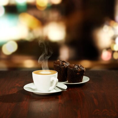 Fresh hot coffee on wooden table in cafe interior and free space for your decoration.