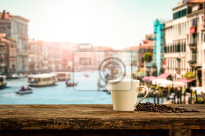 Fresh hot italy coffee and blurred background of city