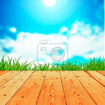 Fresh spring green grass z nieba i podłogi drewniane