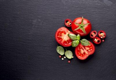 Fototapeta fresh  tomatoes with pepper and basil on black  stone background
