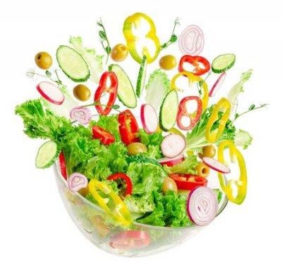 Fototapeta Fresh vegetable salad in transparent bowl with flying ingredients isolated on white. Proper nutrition.