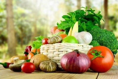 Fototapeta Fresh vegetables on wooden and blurred garden background.