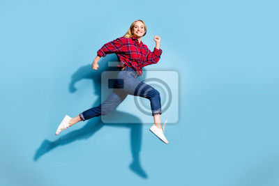 Fototapeta Full length body size profile side view portrait of nice charming attractive cheerful cheery girl wearing checked shirt having fun isolated on teal turquoise bright vivid shine background