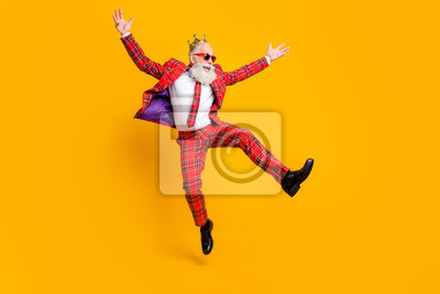 Fototapeta Full length body size view of his he nice handsome attractive cheerful cheery carefree gray-haired man jumping having fun rejoice isolated over bright vivid shine vibrant yellow color background