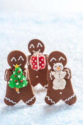 Fototapeta Funny Gingerbread cookie men with tiny marzipan snowman