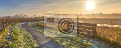 Fototapeta Gate in misty agricultural landscape