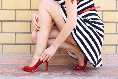 Fototapeta girl legs in red high heel shoes and short skirt outdoor