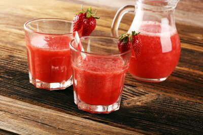 Glass of Sweet fresh strawberry juice and fresh strawberries on table. Healthy food and drink concept