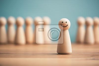 Fototapeta Glücklich aus der Masse hervorstechen
