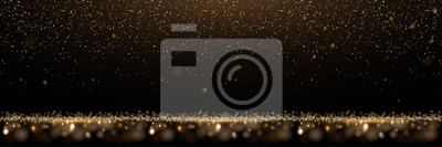 Fototapeta Gold glitter and shiny golden rain on black background. Vector horizontal luxury background.