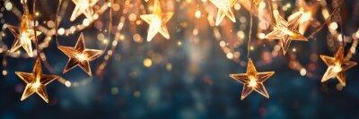 Fototapeta Gold star light hanging on dark background