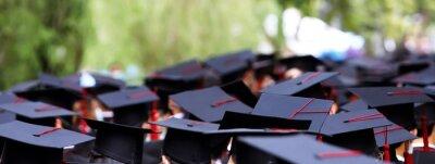 Fototapeta Graduates Receive A Certificate At The University