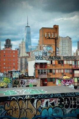 Fototapeta Graffiti i budynki miejskie w centrum Manhattanu.