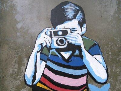 Fototapeta Graffiti sztuka chłopak biorąc zdjęcie.