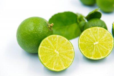 Fototapeta green lemons on white background