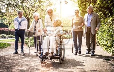 Fototapeta Group of old people walking outdoor