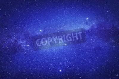Fototapeta Gwiaździste niebo z wielu gwiazd i Droga Mleczna na tle przestrzeni kosmicznej.